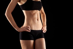 Woman with a flat stomach and toned abs