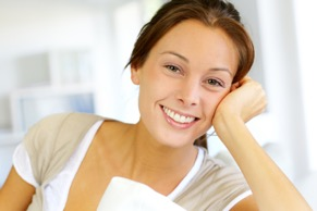 Woman sitting on the couch smiling