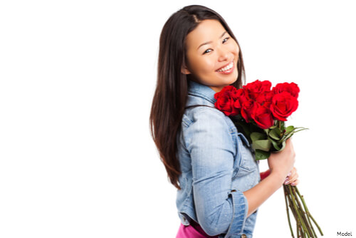 Woman holding roses and smiling
