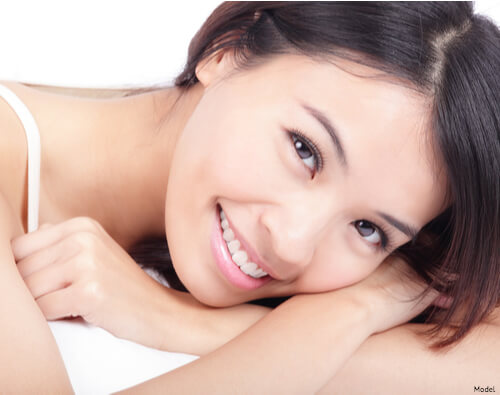 Woman laying down and smiling