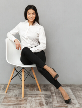 Woman sitting in a chair smiling