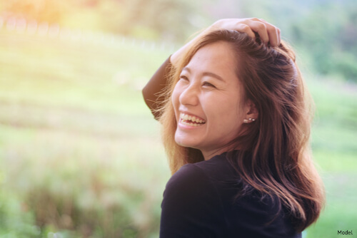 Woman smiling into the sunlight