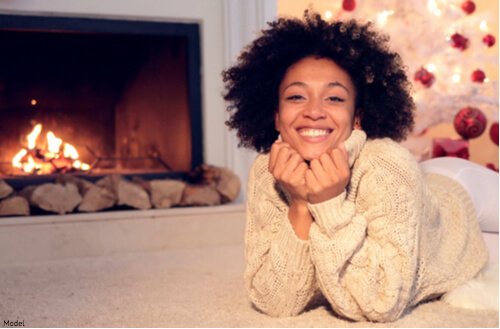 woman sitting next to a fire